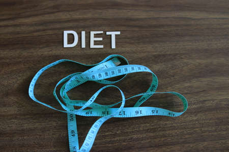 the word diet next to measuring tape. theme of losing weight 写真素材