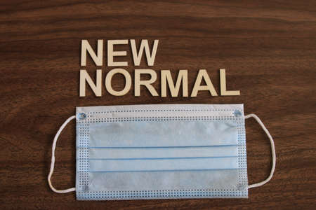 the term new normal on wood background