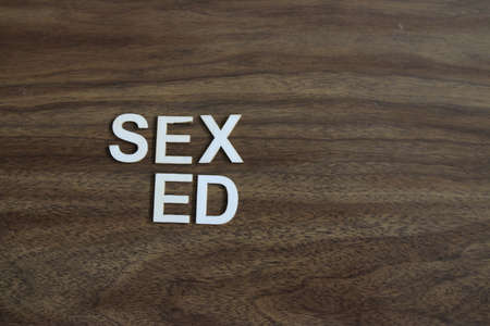 Wooden blocks with phrase `SEX ED` on light blue background. 写真素材