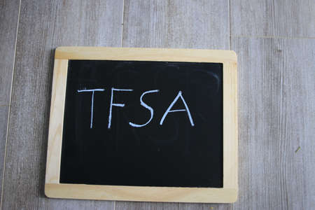 tfsa wrote on a chalk board. TFSA is a canadian savings scheme Banco de Imagens