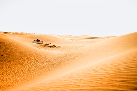 tourist feature: Big tent in desert. Human mark in desert dune Stock Photo