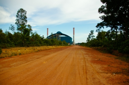 chimney power plant sky environtment green brown soil photo