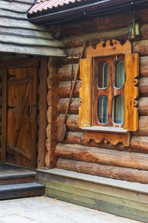 timbered: Detail of Old Wooden Rural House - Window on Timbered Wall and Door