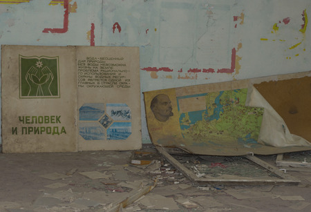 PRIPYAT, UKRAINE - JUNE 25, 2017: Abandoned Room In Ghost Town of Chernobyl Within Chernobyl Alienation Zone. Text on book, Man and nature. Life is impossible without water. Saving of water resources is the main task. Editorial
