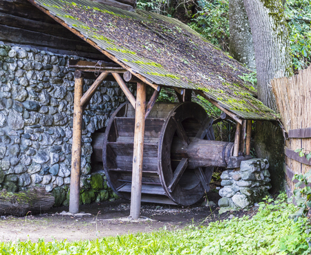 Old wooden water mill in country yard Stock Photo