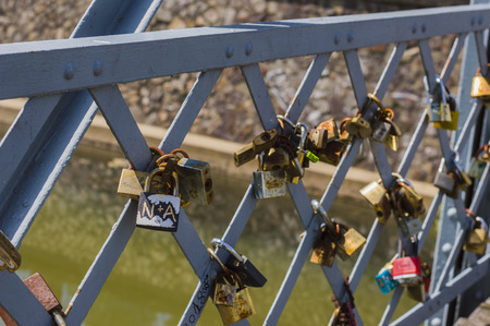 CLUJ-NAPOCA, ROMANIA - JULY 29, 2018: old love padlocks on  Elizabeta Bridge railing  on Somes River in Cluj, Transylvania