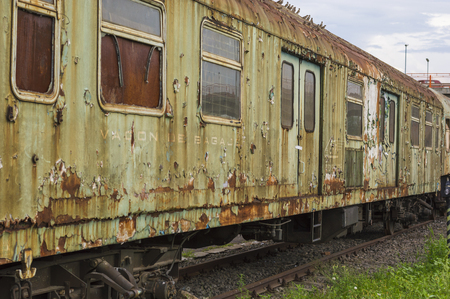 SIBIU, ROMANIA - JULY 30, 2018: old abandoned train waggons at Sibiu railway station Editorial