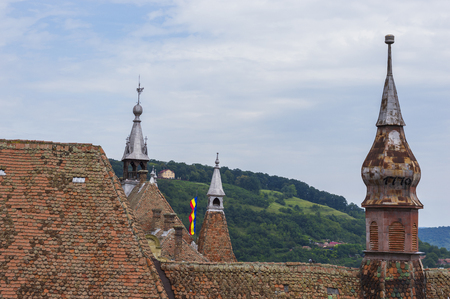Roof of Monastery Church on Background of Woody Landscape in Sighisoara, Transylvania Stock Photo