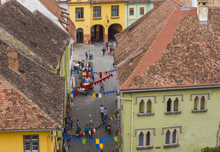 SIGHISOARA, ROMANIA - AUGUST 1, 2018: high angle view of town street in historical center of Sighisoara, Transylvania