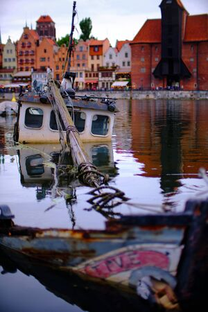 """Boat wreck in the marina of GdaÅ""""sk (Danzig in German) a port city on the Baltic coast of Poland Stock fotó"""