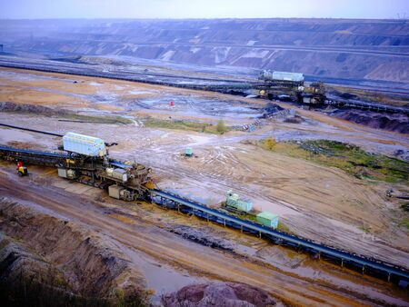 Huge machines in an lignite opencast in a misty and rainy autumn athmosphere