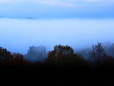 Morning mist, covering the valley of the river rhine, revealing the old walls of the Castle Rheinfels