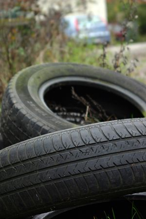 pneu: Black tyres abandoned on the ground, a sign of pollution