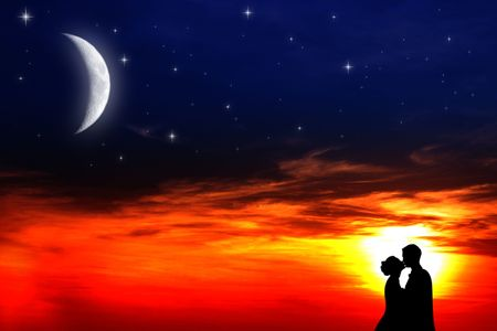 Two young lovers kissing at sunset