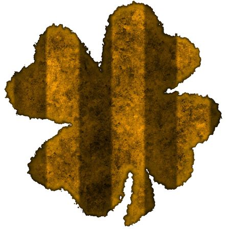 Burnt parchment with the shape of the typical Saint Patricks day celebration clovers photo