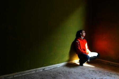 sanitarium: Boy all alone in an empty dirt room