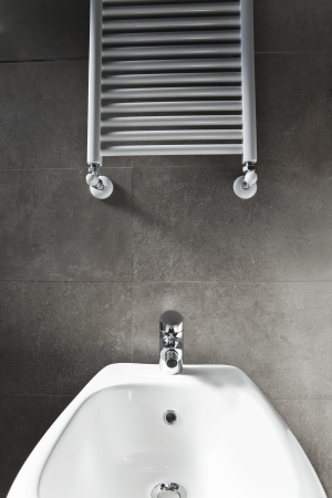 White porcelain bidet and heater  photo