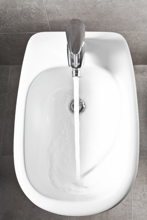 White porcelain entire bidet above sight  photo