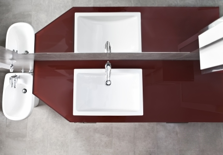 Bathroom sink, bidet and mirror reflection from above photo