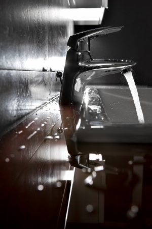 Bathroom sink silhouette lighted by backlight  Stock Photo