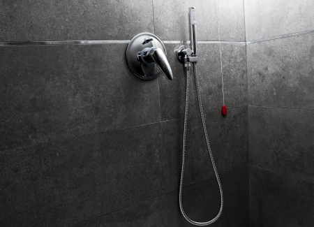 Shower handle and head in the darkness