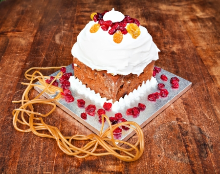 Christmas cake with cream, red berries and xmas decorations Stock Photo - 16886022