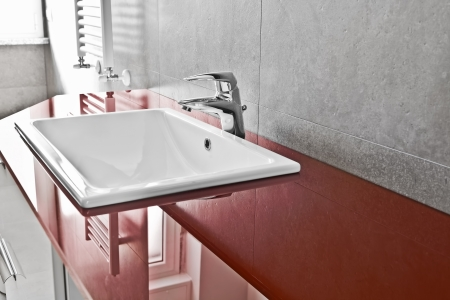 Bathroom red lavabo board with translucent surface photo