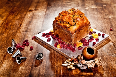 Christmas cake with red berries metal tips and xmas decorations Stock Photo - 16971403