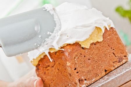 Spreading cream on christmas cake icing with spatula Stock Photo - 17241231
