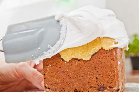 Spreading cream on christmas cake icing with spatula Stock Photo - 17241229
