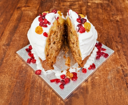 Christmas cake with cream and red berries cutted in two slices Stock Photo - 17461860