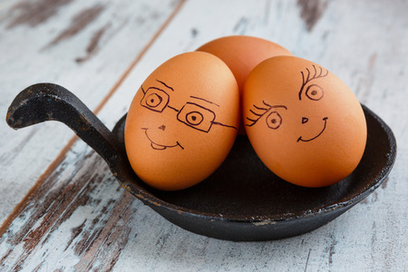 cast iron: Smiling eggs for breakfast on a cast iron skillet