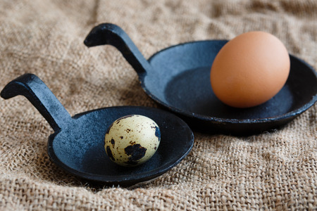 cast iron: Quail and chicken eggs on a cast iron skillet