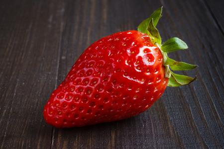 Strawberry on dark wooden background Banque d'images