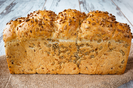 Fresh bread with sunflower seeds on burlap
