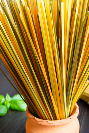 Traditional colored italian spaghetti on old background Banque d'images