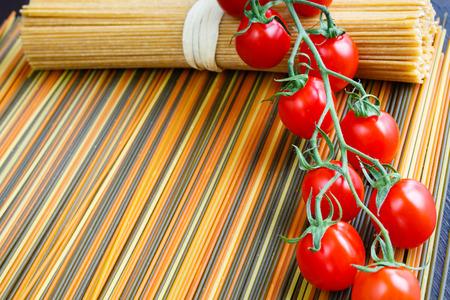 Colored italian spaghetti with mini tomatoes