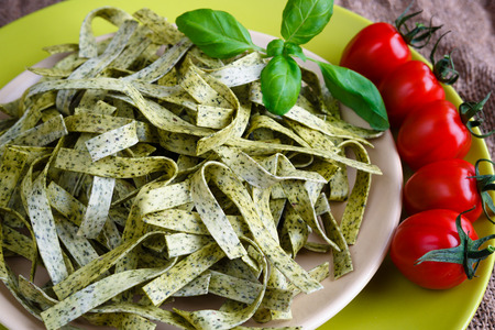 Pasta tagliatelle with spinach, basil and cherry tomatoes