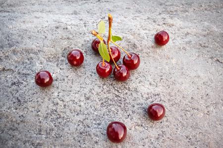 Sweet ripe cherry in the garden on stone