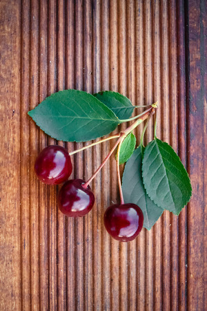 Sweet ripe cherry on wooden background