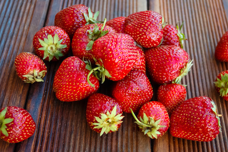 Fresh garden strawberries on old wooden background