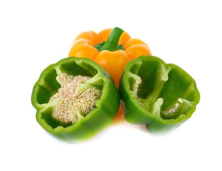 yello: fresh green and yello pepper (capsicum) on a white background