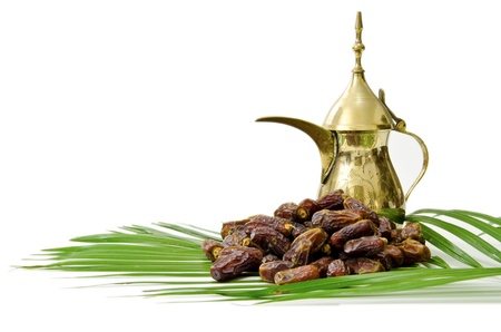Arabic Coffee with Dates Fruit isolated on white Background photo