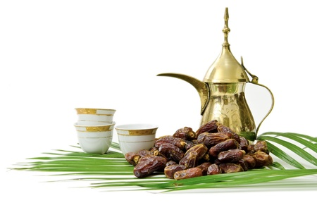 Arabic Coffee with Dates Fruit isolated on white Background