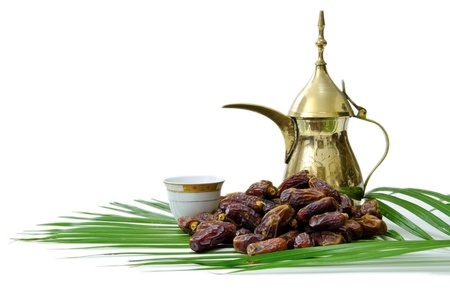 Arabic Coffee with Dates Fruit isolated on white Background Stock Photo