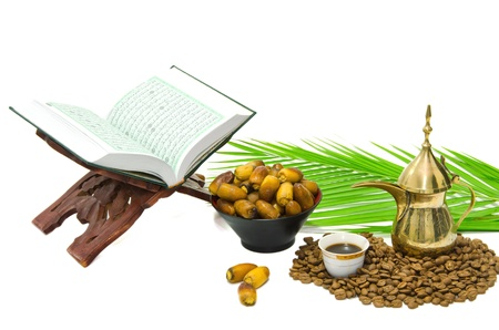 the holy quran and  arabic coffee with date fruit photo