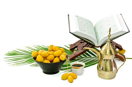 arabic coffee: the holy quran and  arabic coffee with date fruit on white background