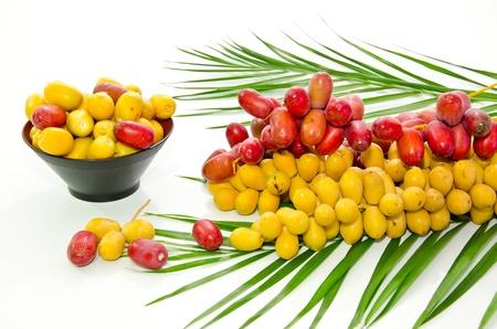 fresh date fruit on white background