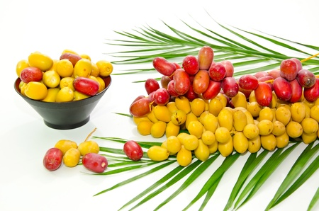 green dates: fresh date fruit on white background