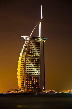 DUBAI - JANUARY 4: Burj al Arab hotel, one of the few 7 stars hotel in the world and one of the most recognized luxury symbol at night on JANUARY 4, 2012 in Dubai, United Arab Emirates